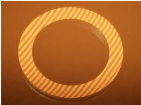 Figura N° 15-8.- Cara de un sello mecánico midiendo la planitud con bandas de luz.
